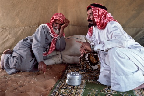 Bedouin Elders talking in the tent at desert campsite